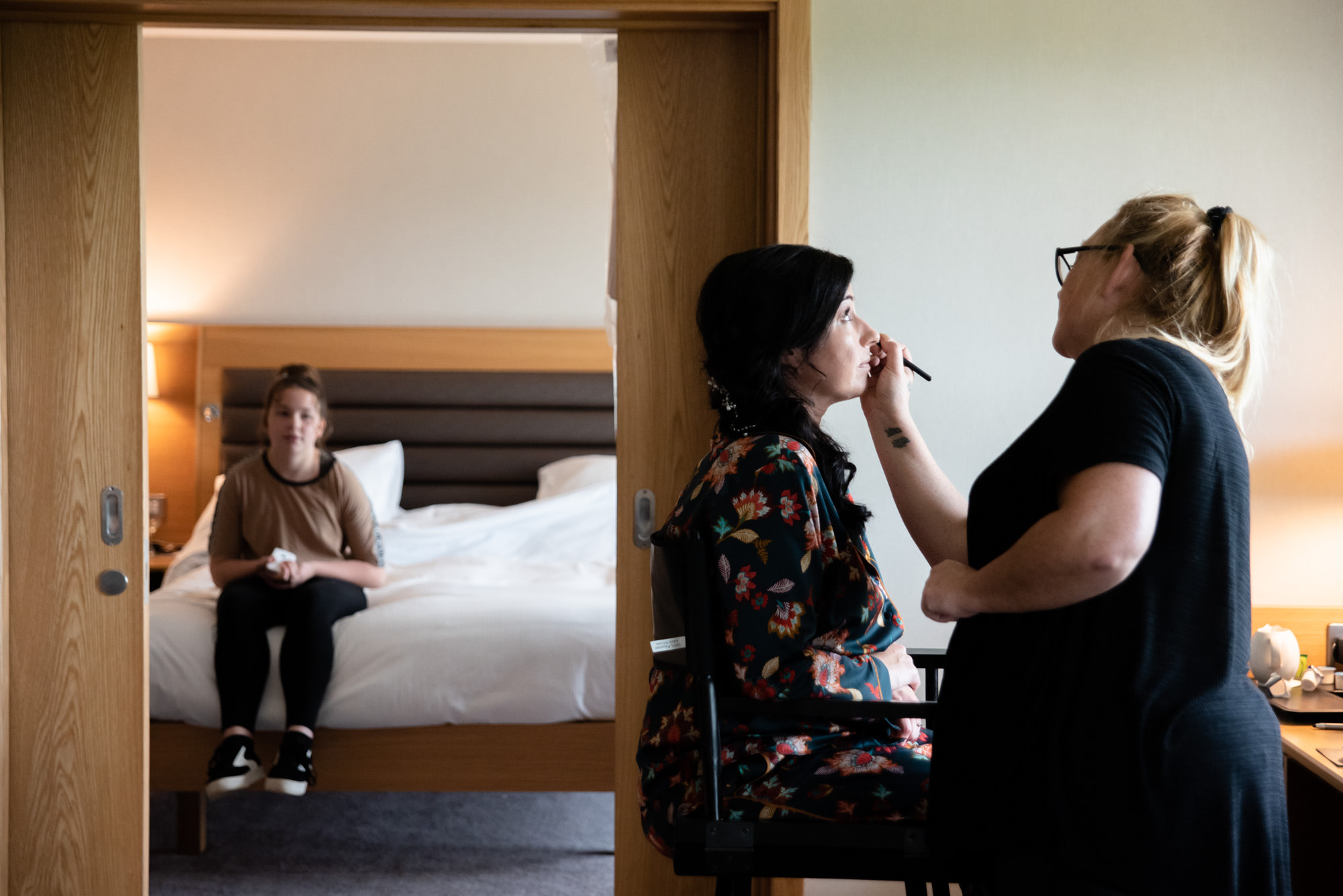 Bride having make up done at The Hilton Hotel