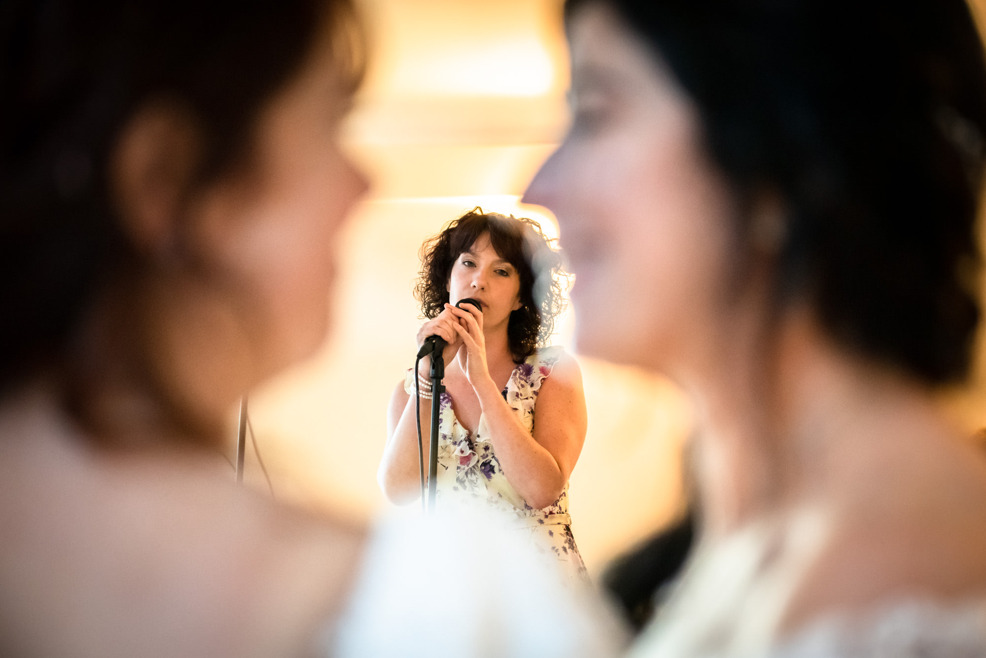 A friend singing for the brides