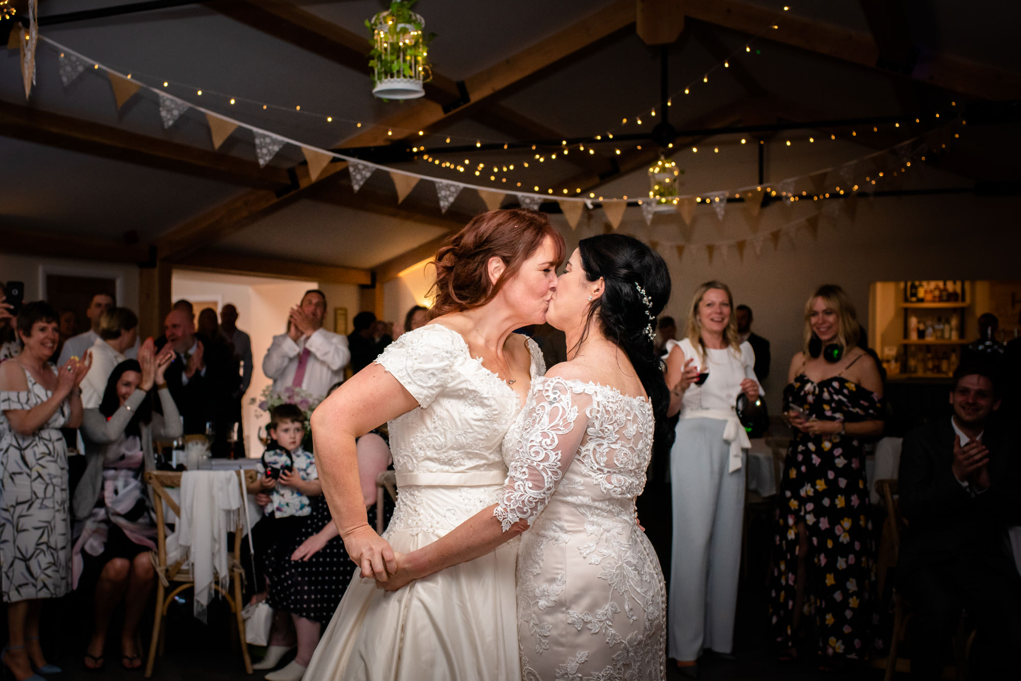 Brides kissing on the dancefloor