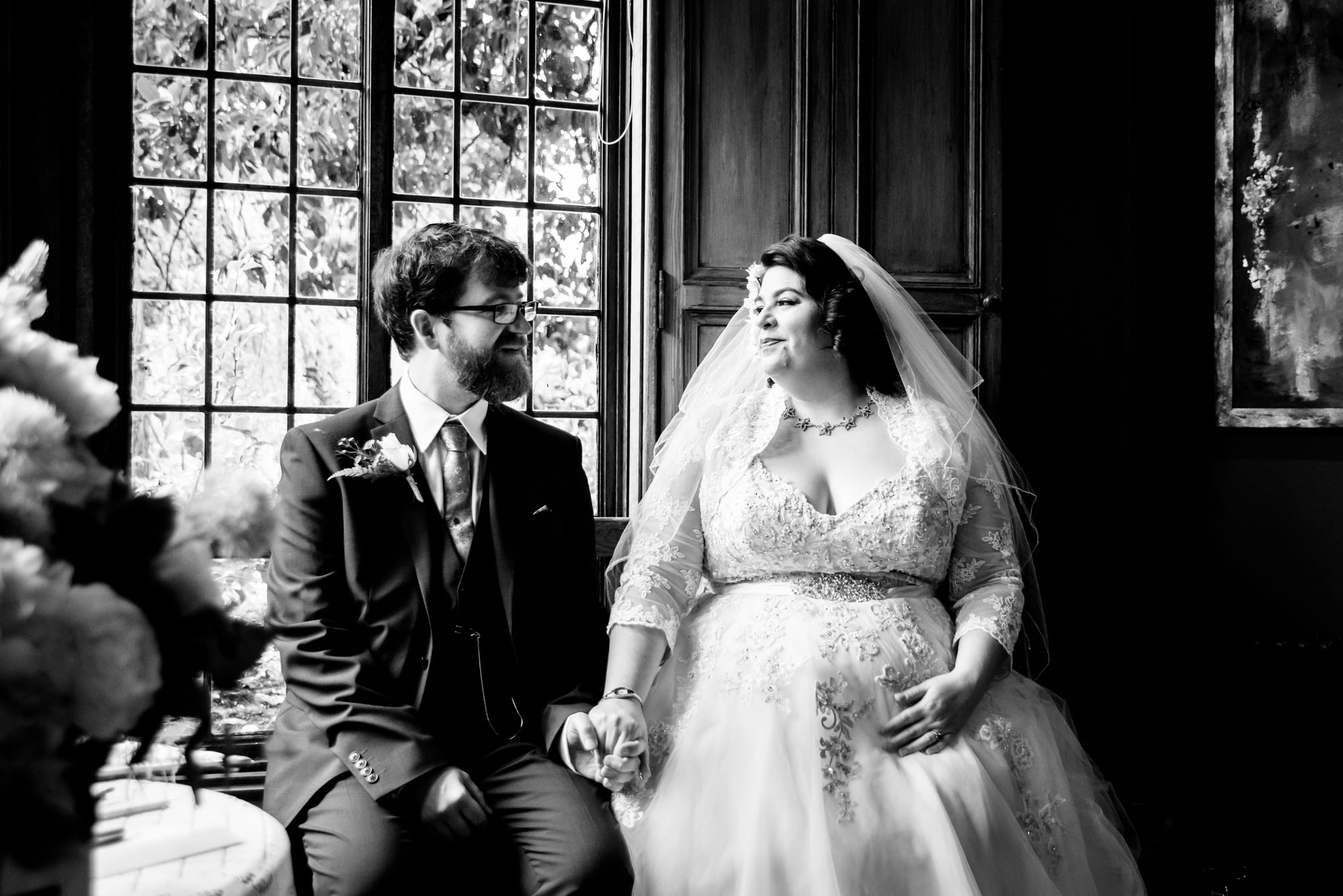 bride and groom listening to reading