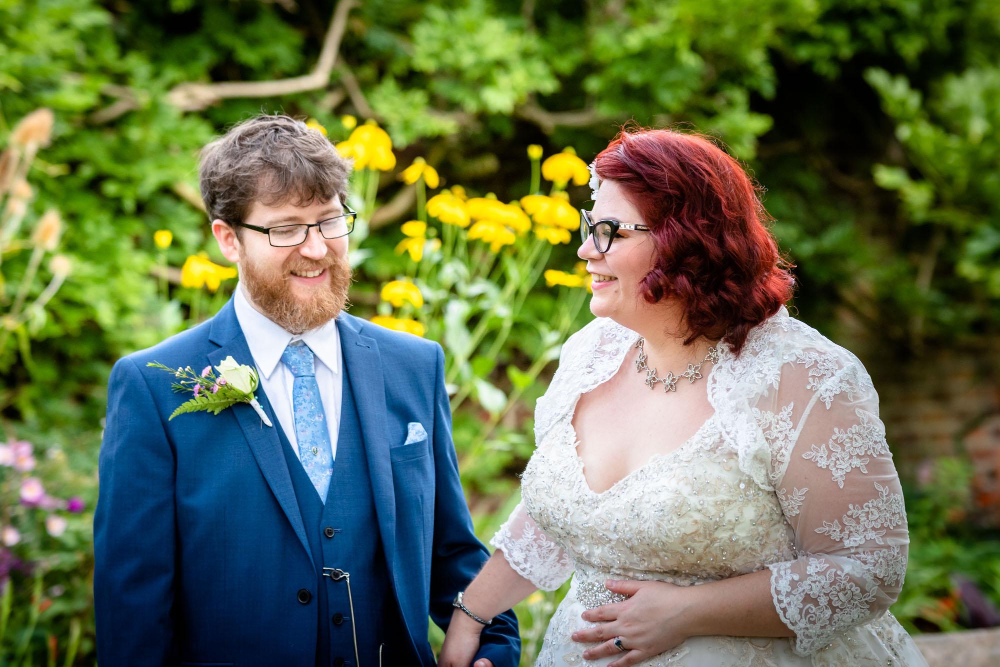 Bride and groom in parsonage garden