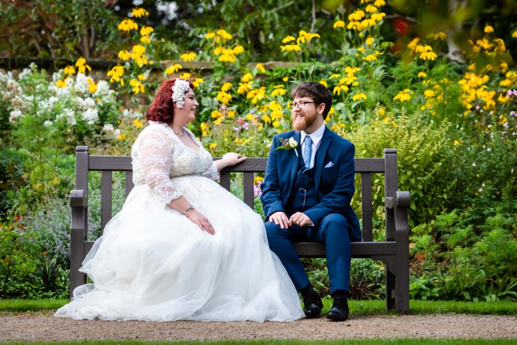 Bride and groom sat down on a bench