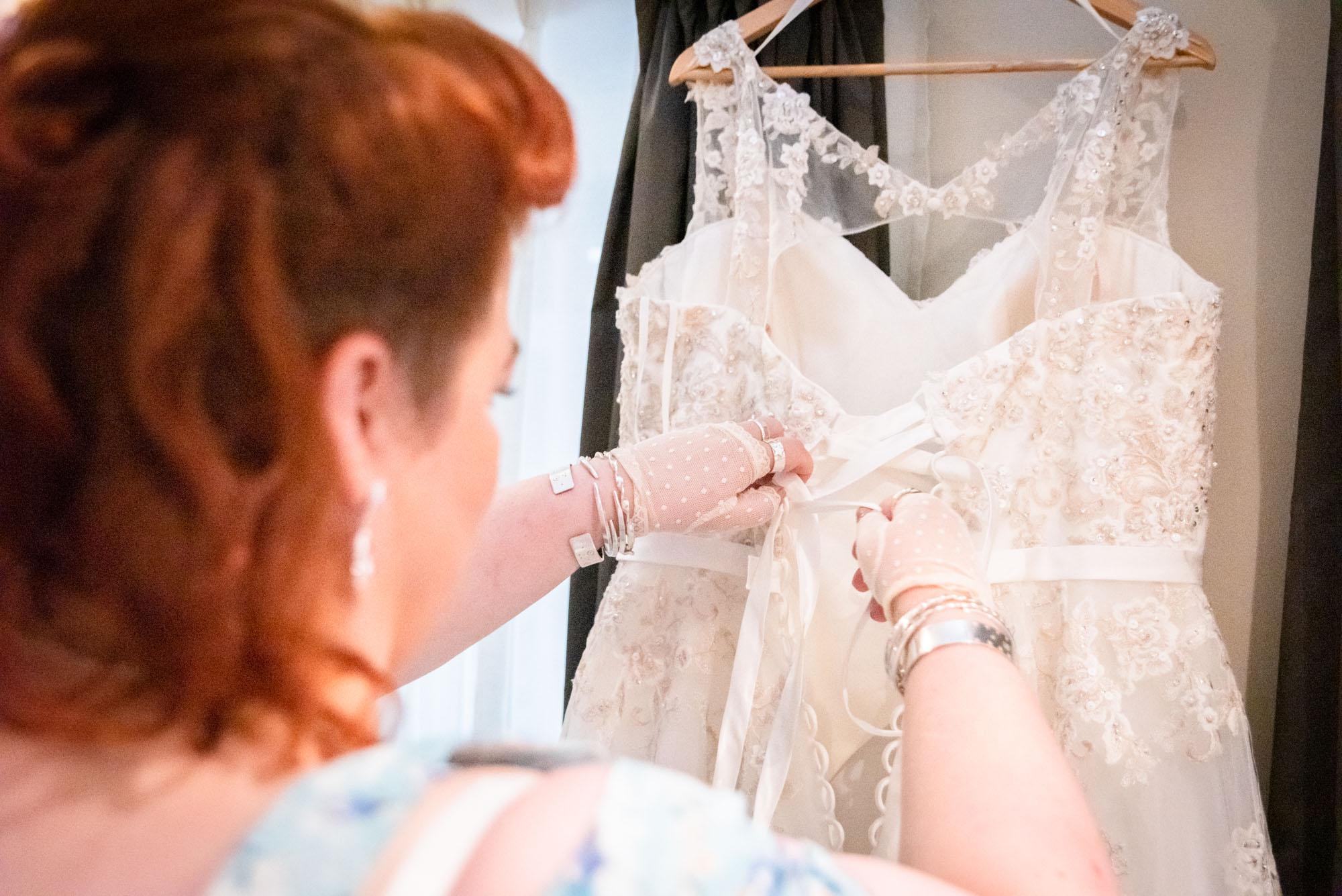 bridesmaid undoing dress