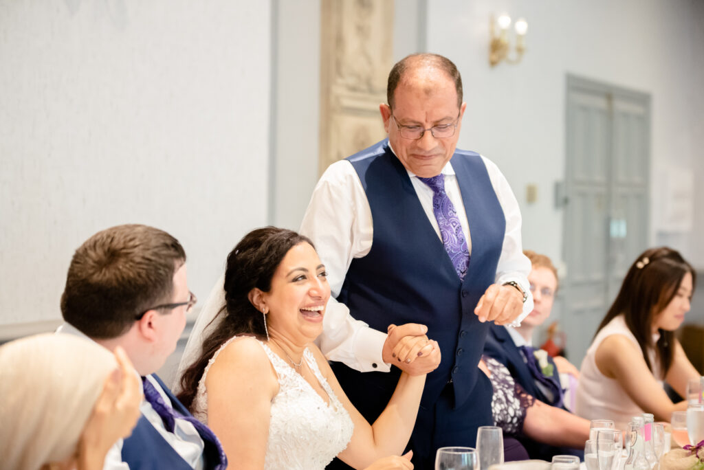 bride laughing at dad speech