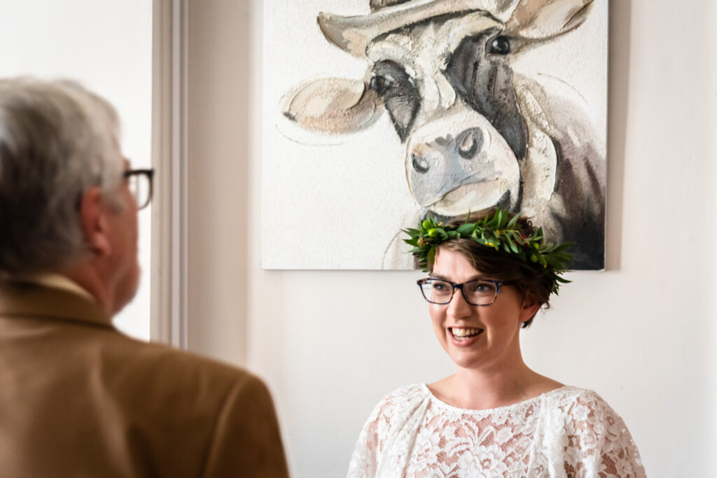 bride with a picture of a cow behind