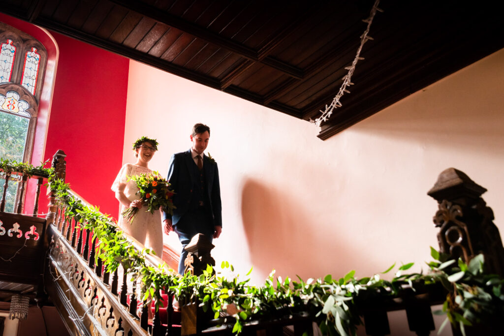 Bride and groom walking down the stairs together