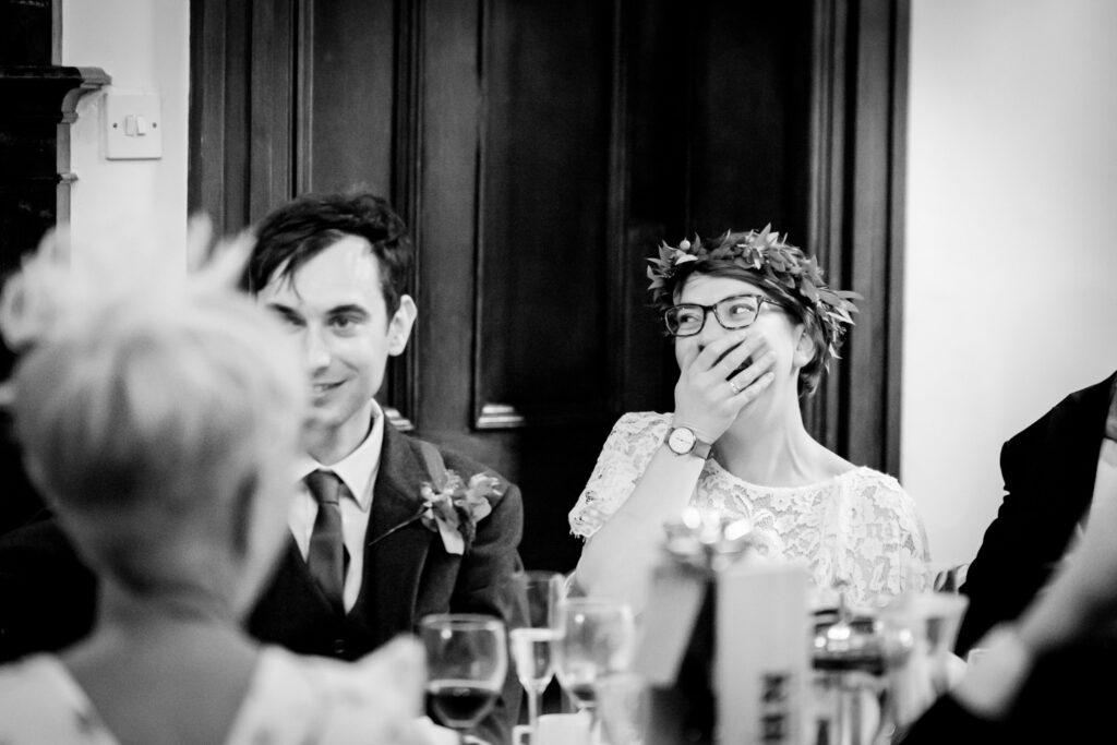 bride covering her mouth