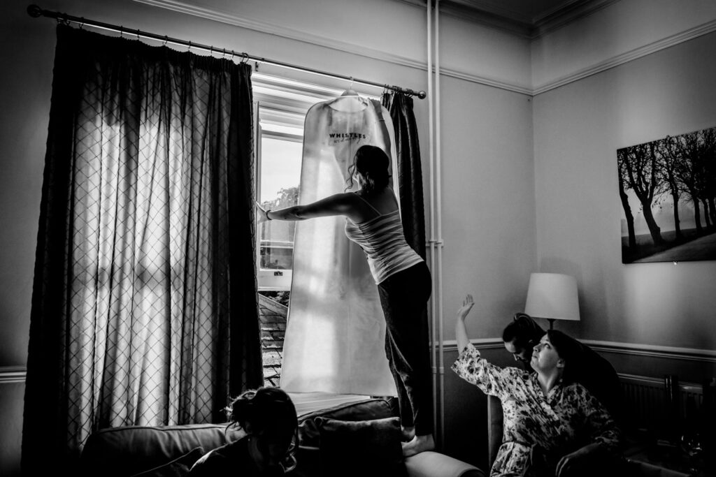 removing the dress from the curtain pol