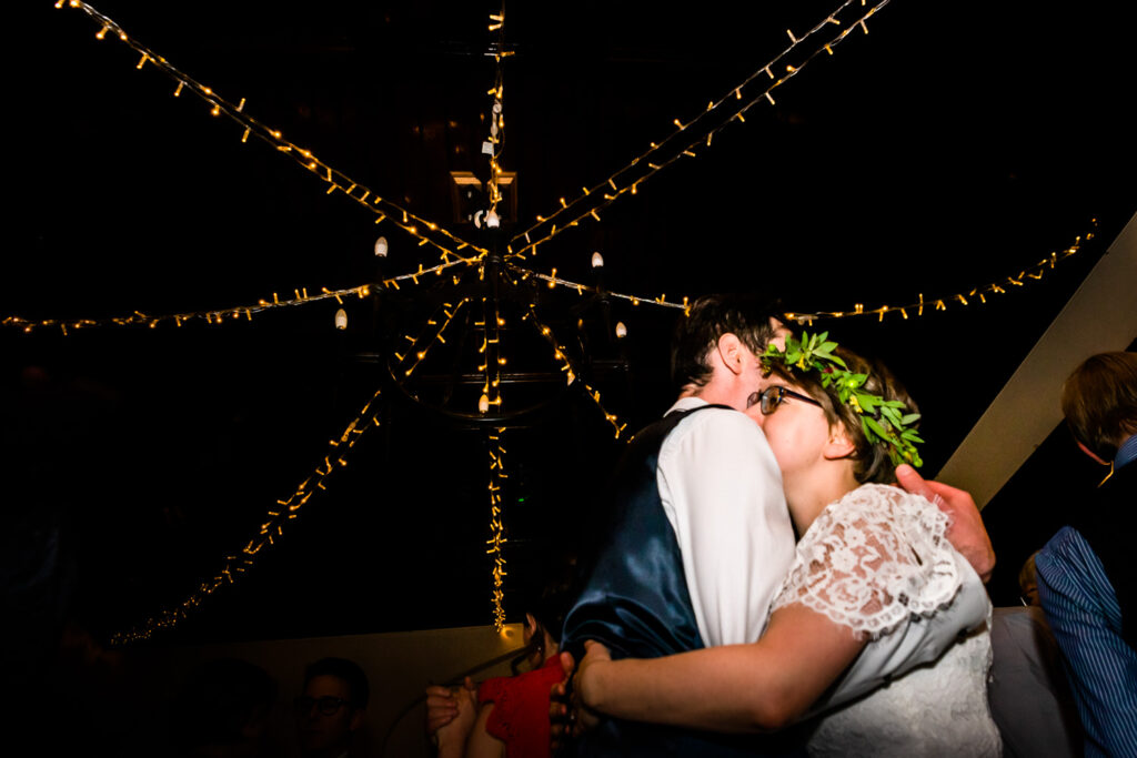 bride and groom on the dancefloor with fairy lights