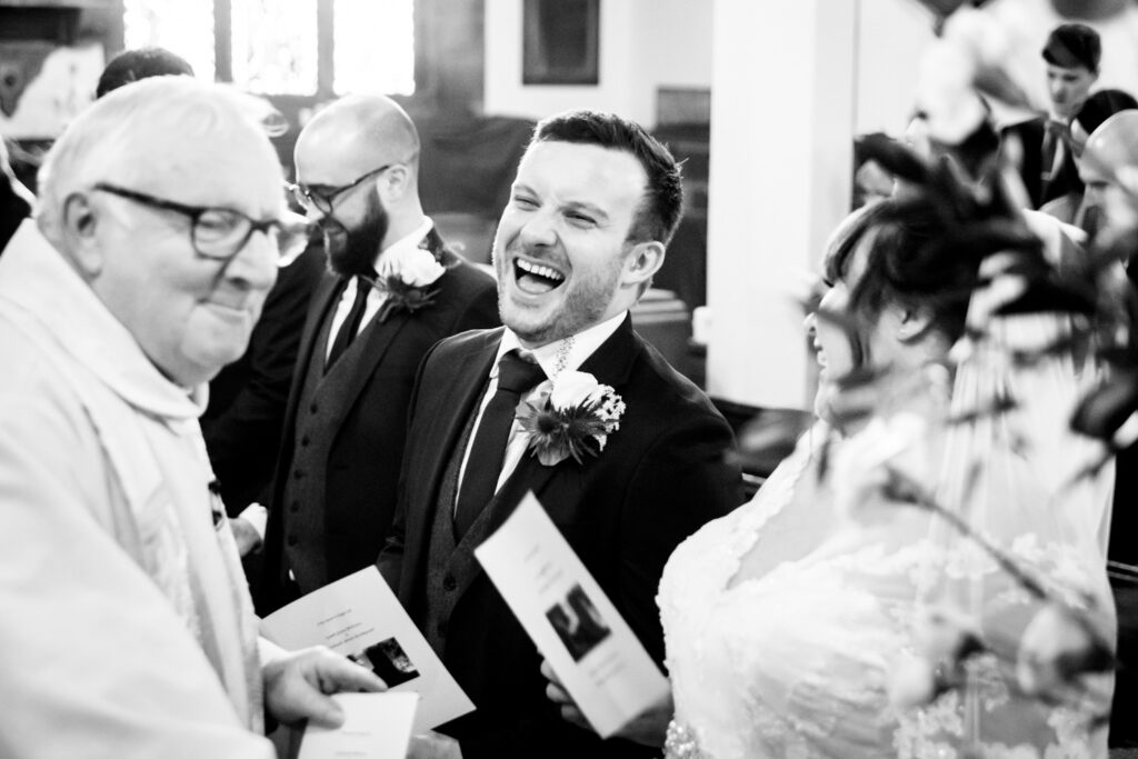 groom laughing during the ceremony