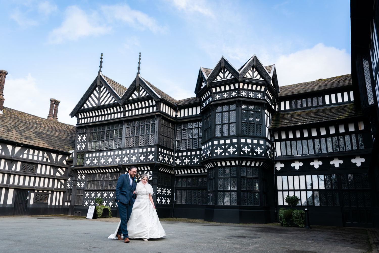 Bride and groom outside Bramall Hall