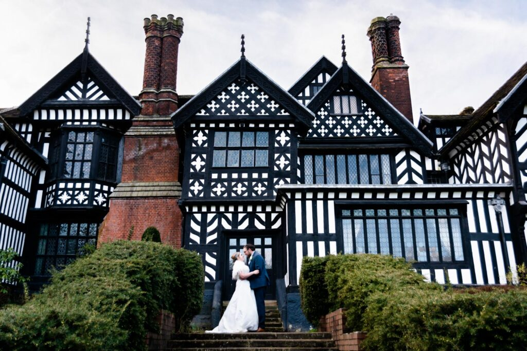Bride and groom at the back of Bramall Hall