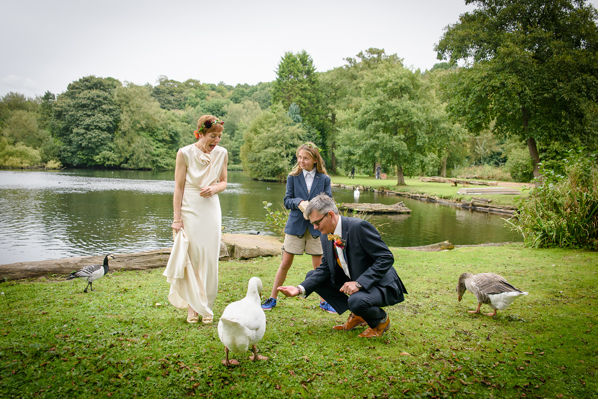 Bride and groom saying hello to the geese and ducks