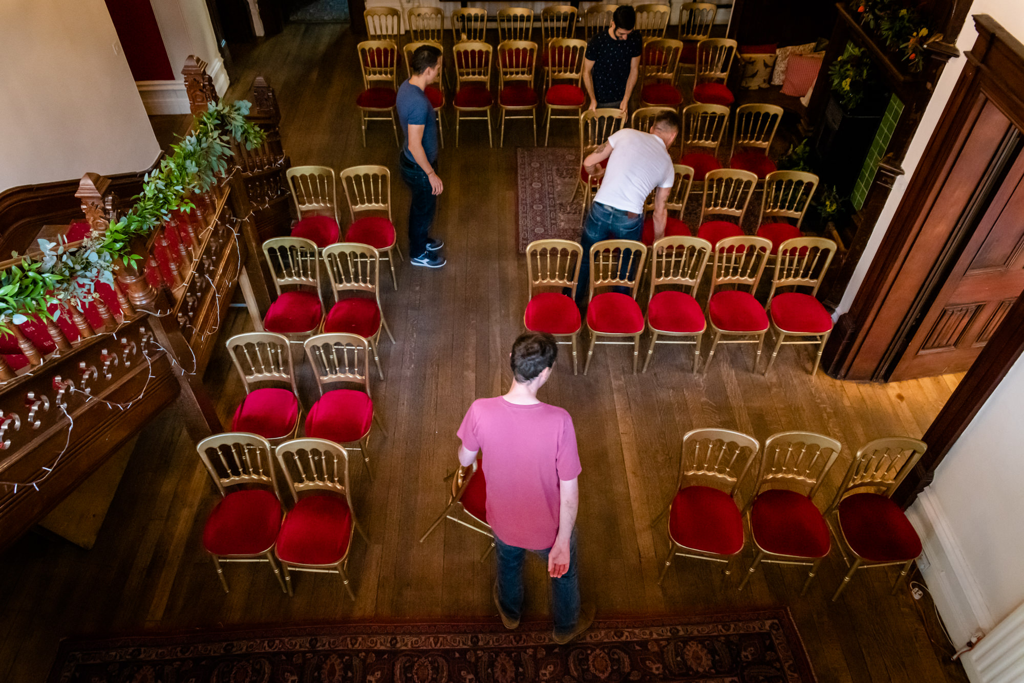 The groom and the family setting up the ceremony room at Hargate Hall