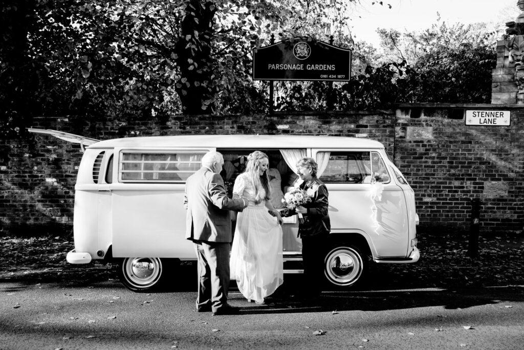 Bride arriving in a vintage VW camper van
