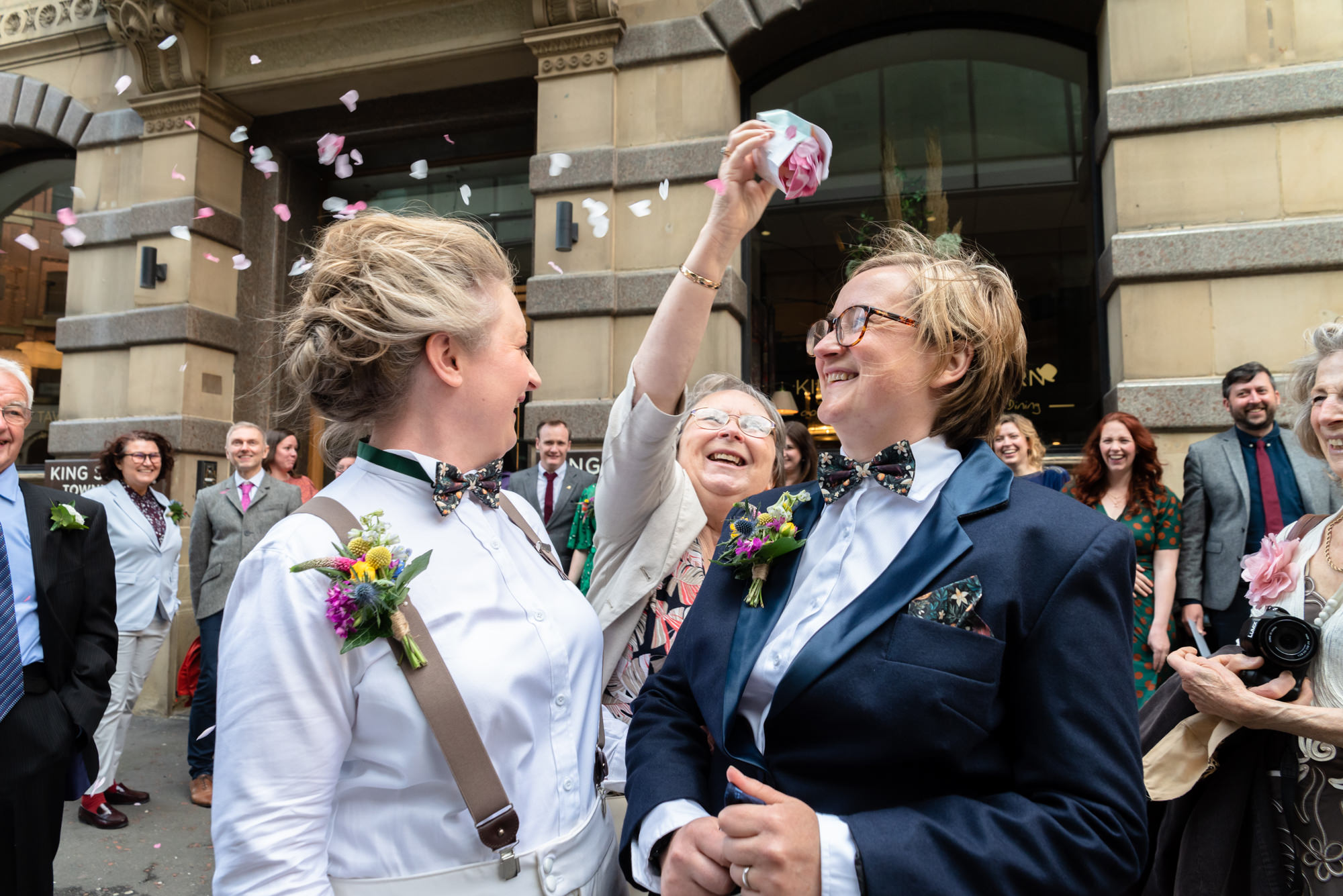 Mother throwing extra confetti outside King Street Townhouse