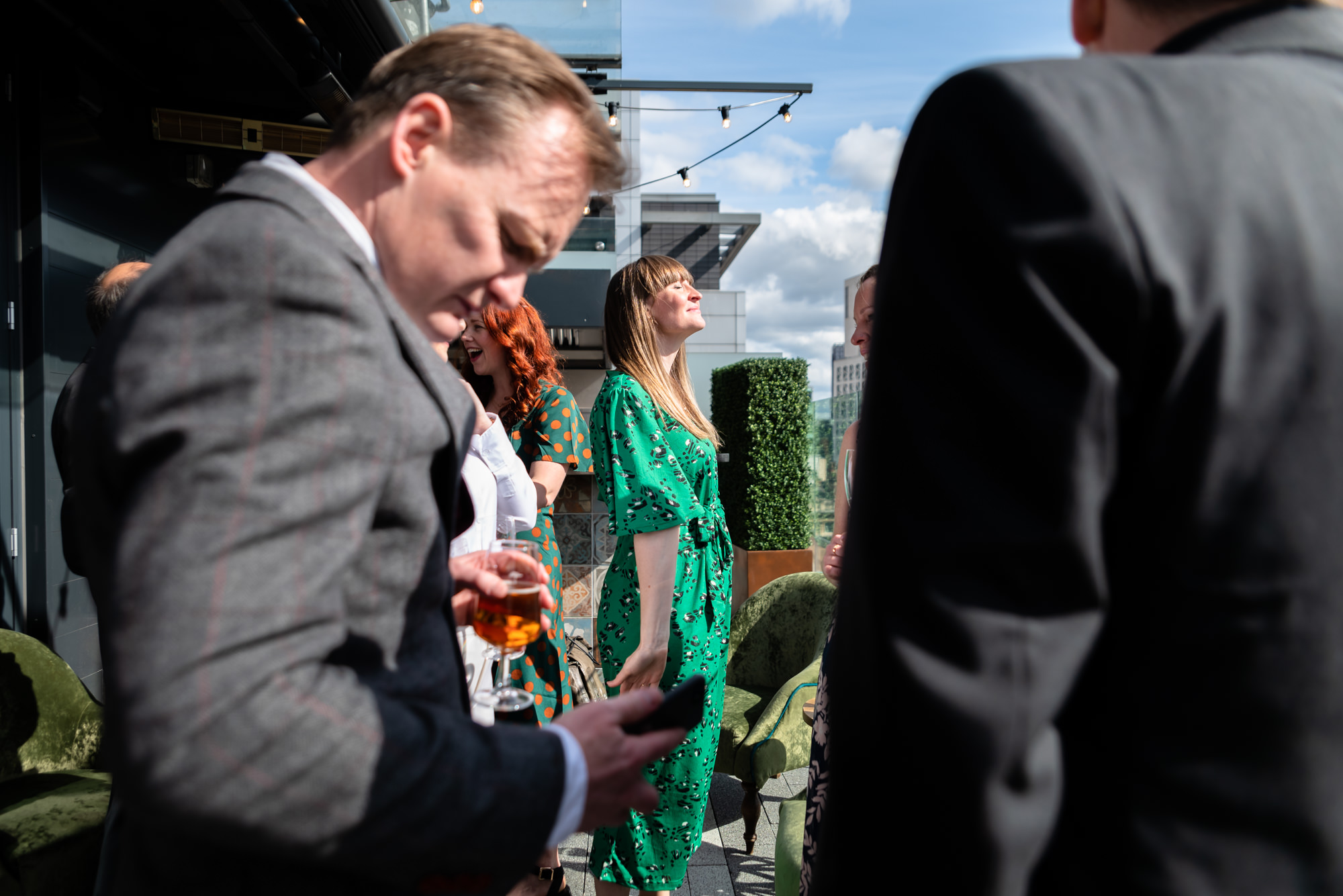 Guest enjoying a bit of sunshine on the rooftop terrace at King Street Townhouse