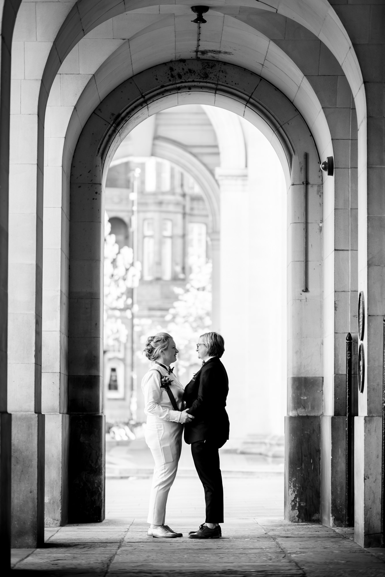 Bridal portraits under Manchester Town Hall's stone arches
