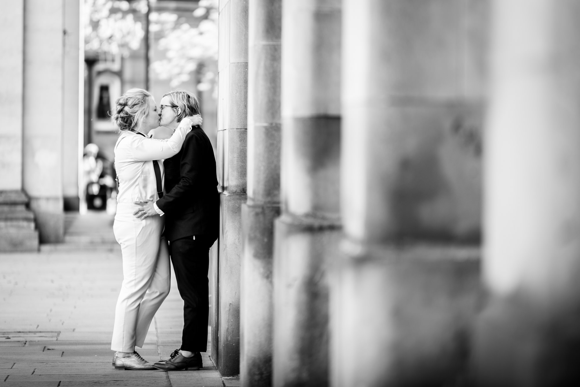 Brides kissing outside Manchester Town Hall