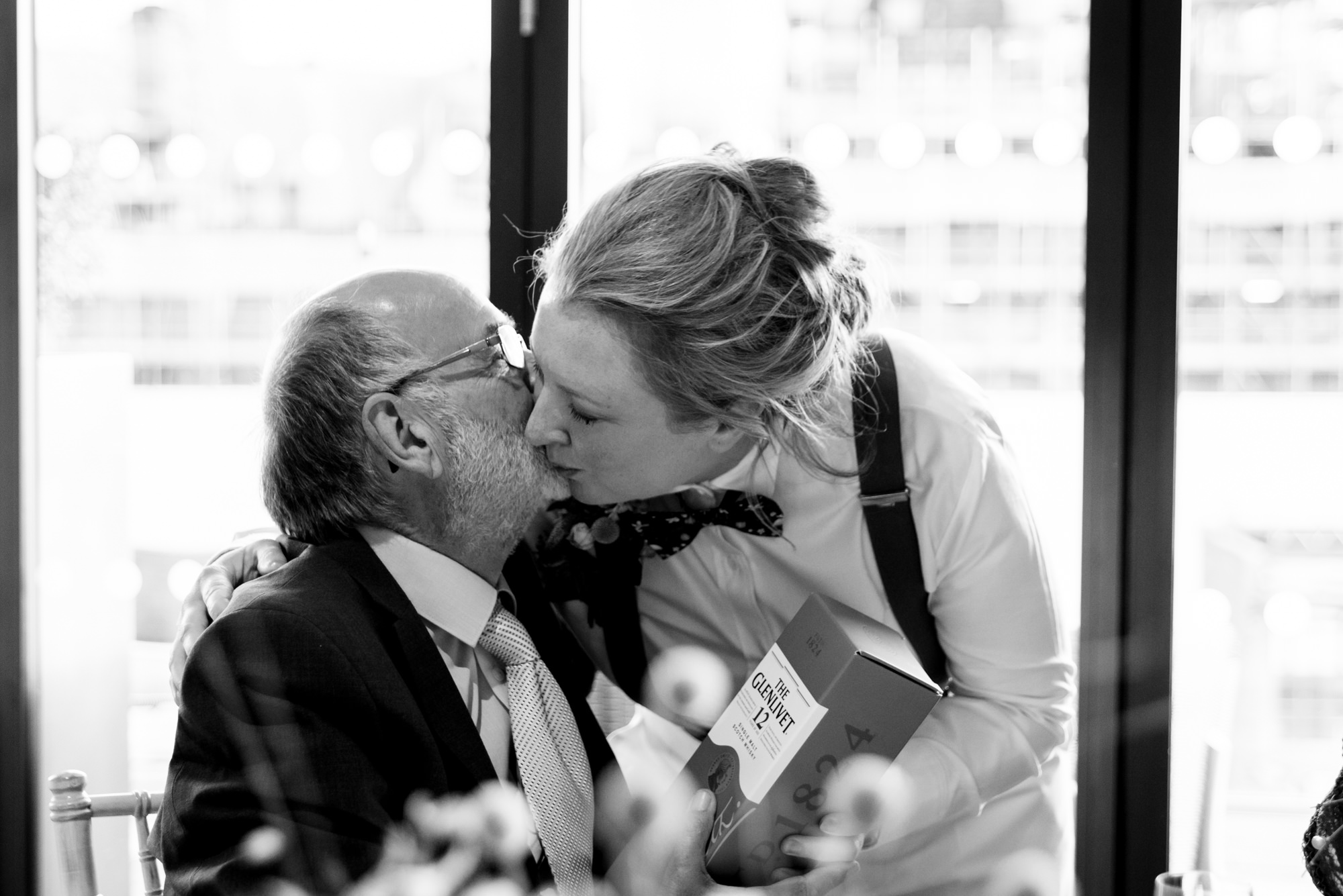Bride giving her dad a gift