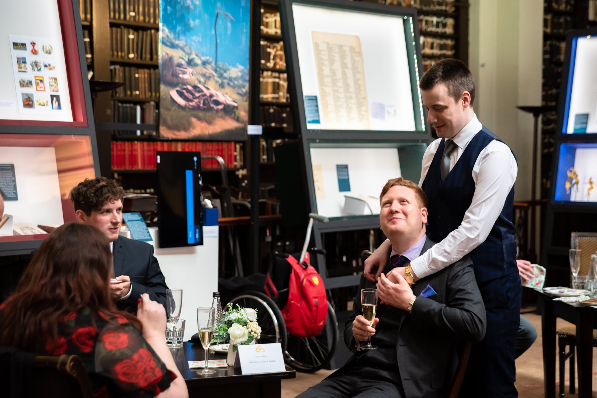 Grooms talking to their guests at The Portico Library