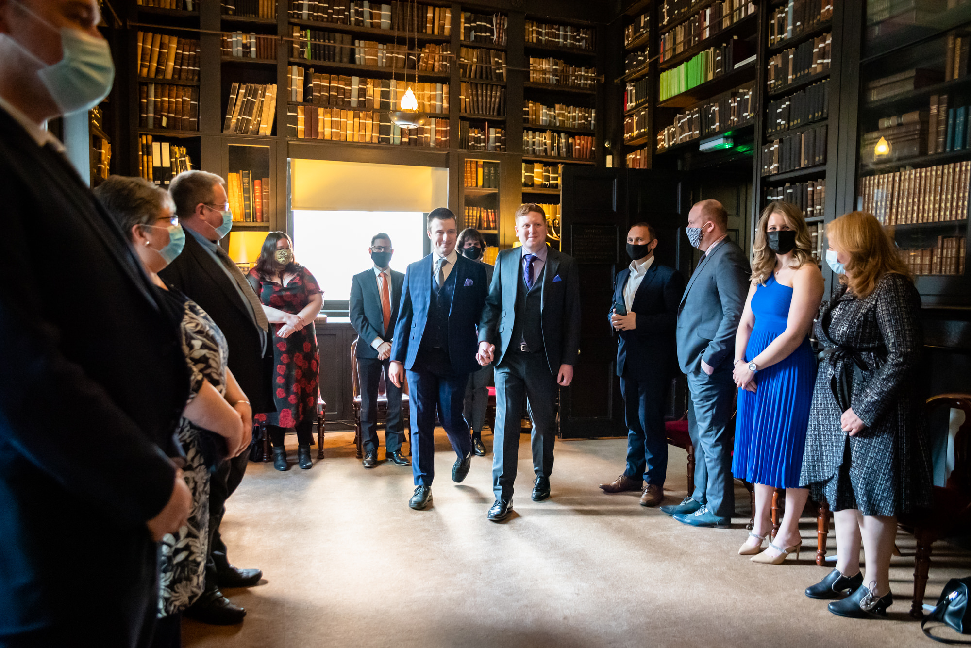 Grooms entering the reading room for their ceremony at The Portico Library