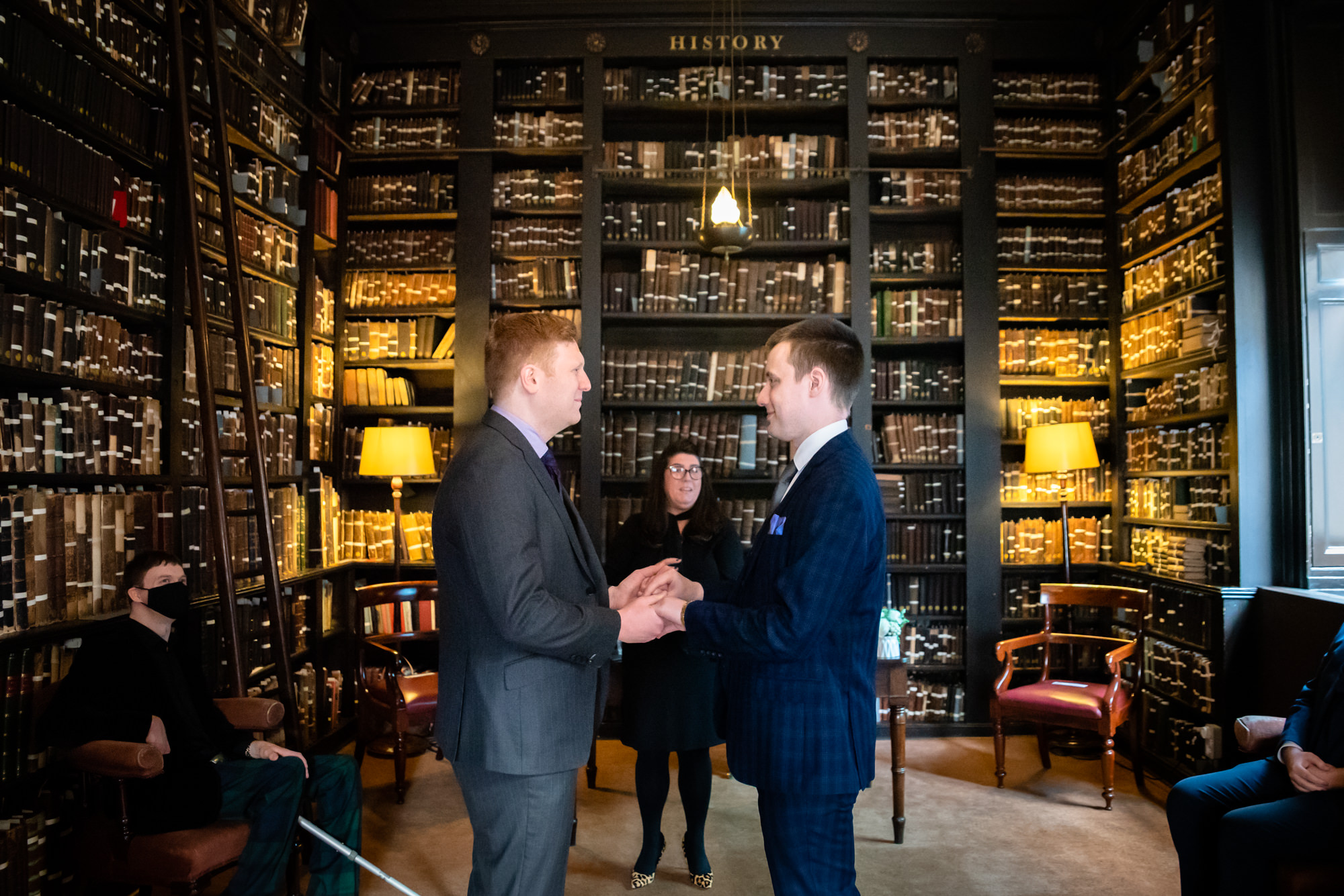 Grooms exchanging vows at The Portico Library