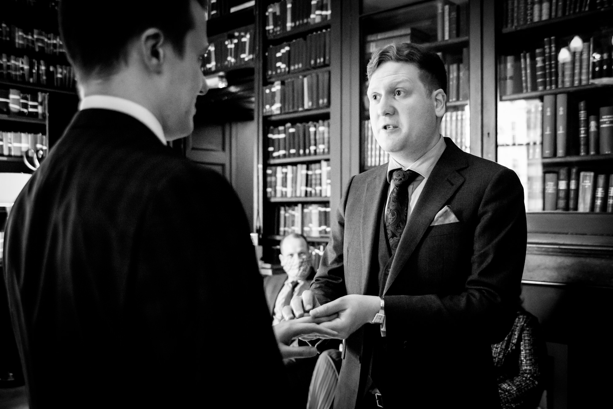 Grooms exchanging their rings at The Portico Library