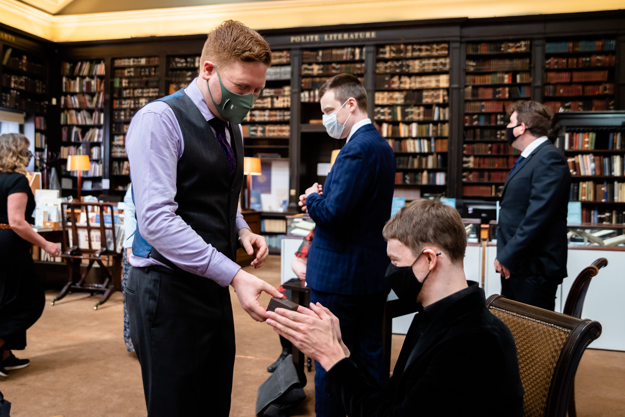 Groom giving the rings to his bestman at The Portico Library