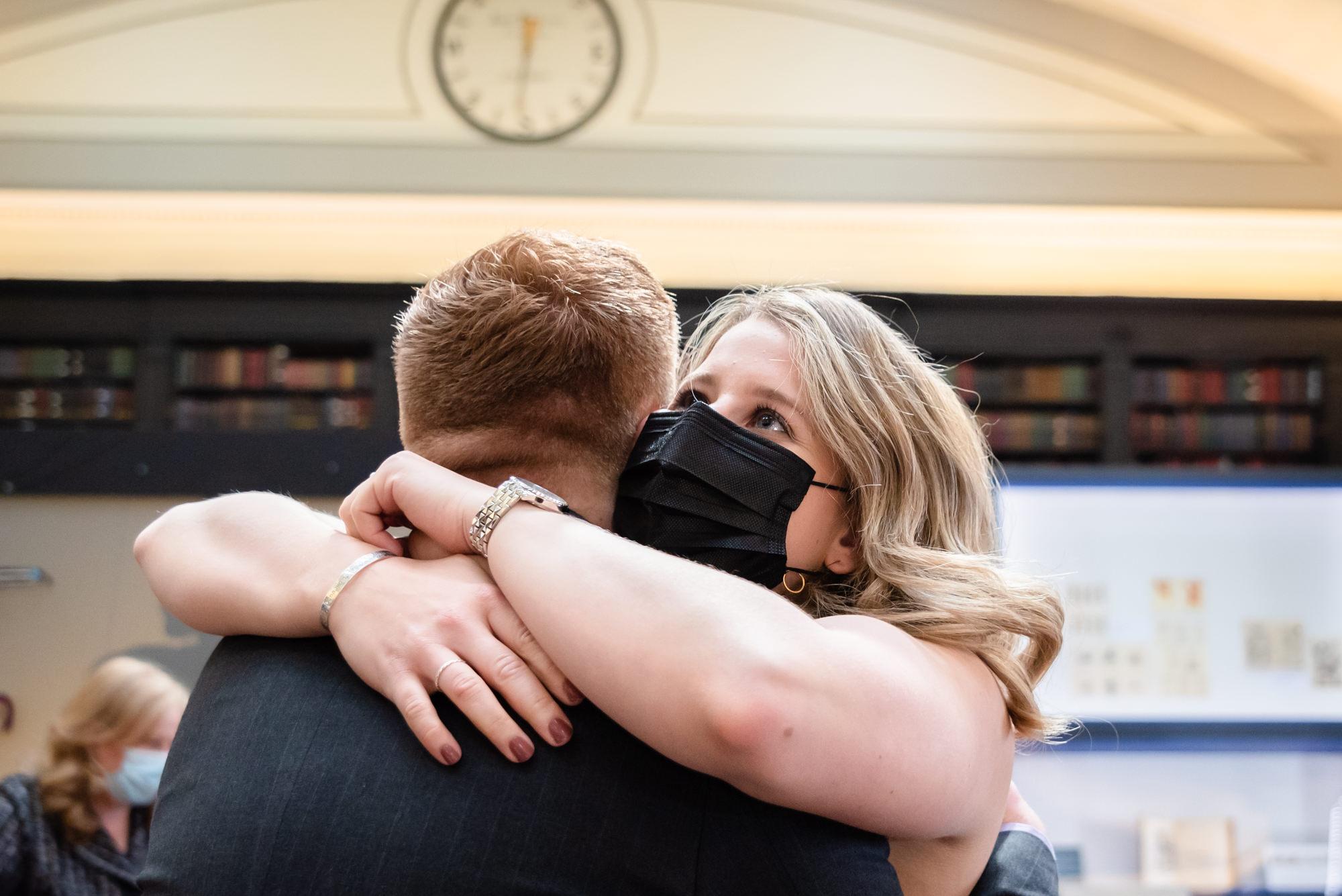 Groom hugging his sister
