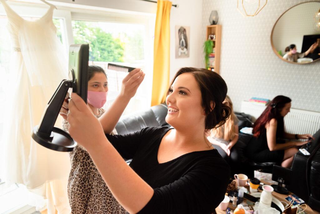 Hairdresser making some adjustments