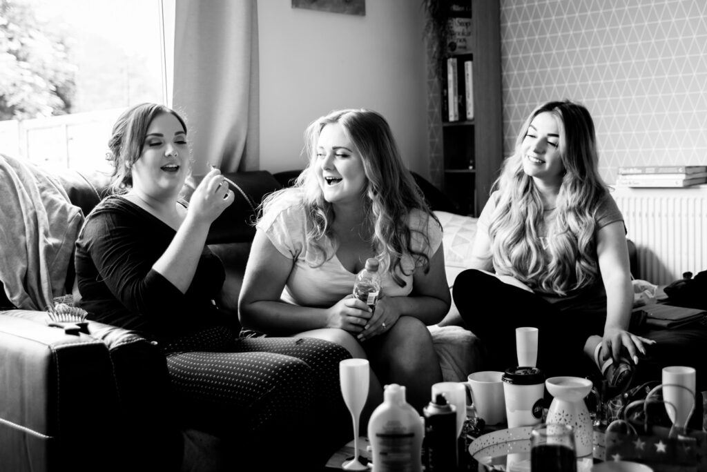 Bride with her bridesmaids during the preparation
