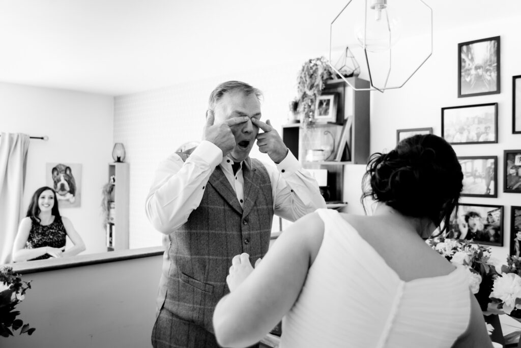 Dad struggling to keep it together after seeing the bride