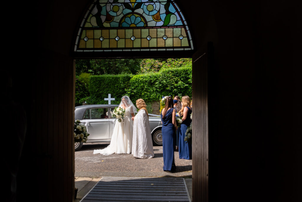 Bride outside the church at st paul's church compstall