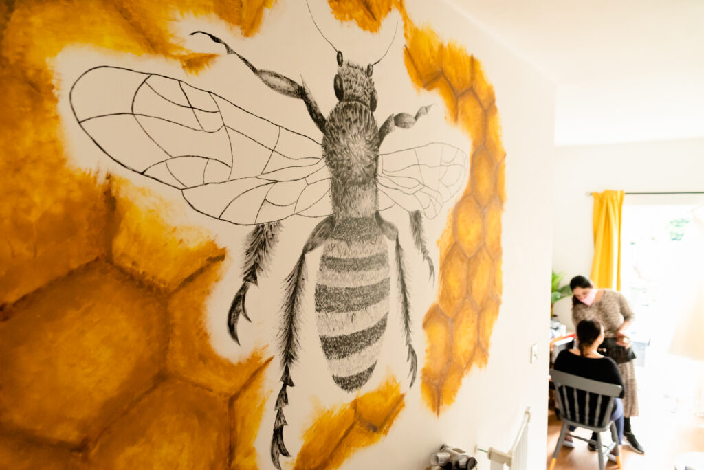 Manchester Bee painted on the wall in the bride's house