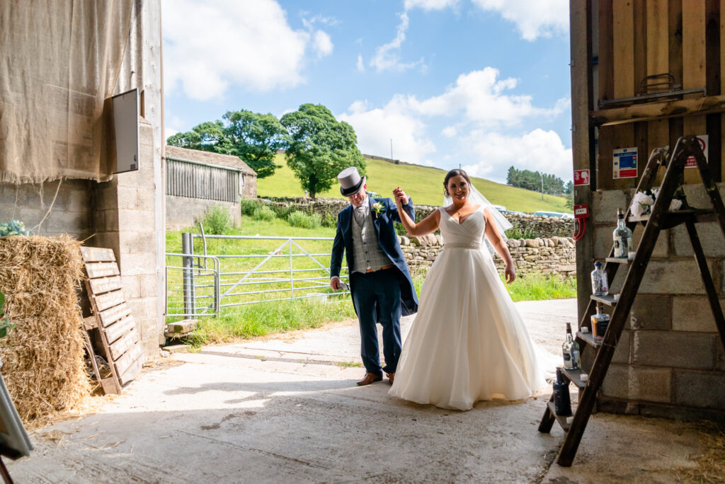 Bride and groom making their entrance at Thornsett Fields Farm