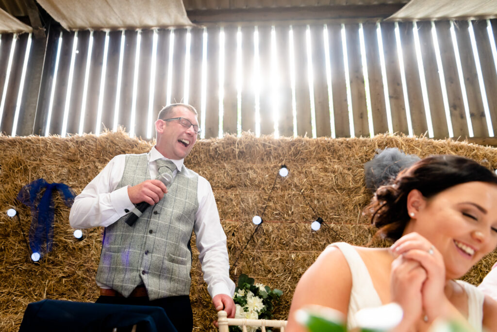 Groom laughing during his speech at Thornsett Fields Farm