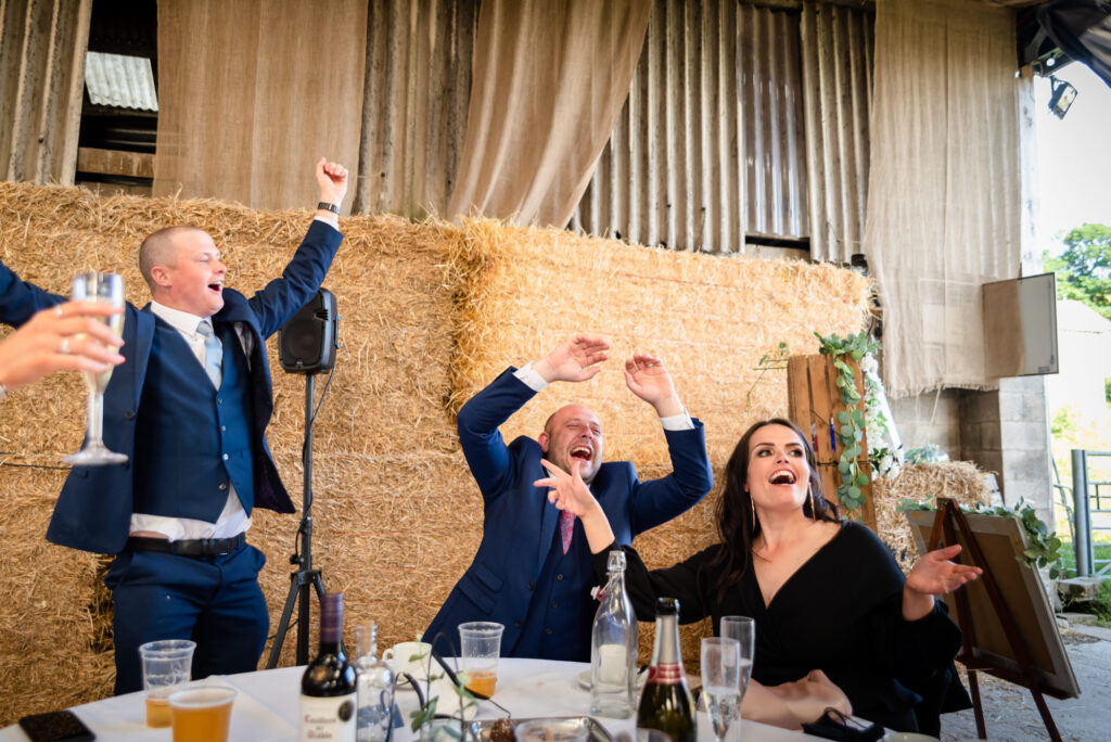 Guest singing and dancing at the table
