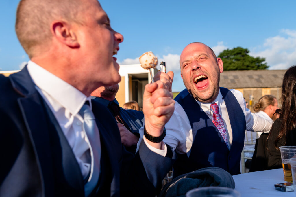Wedding guest singing using a popsicle