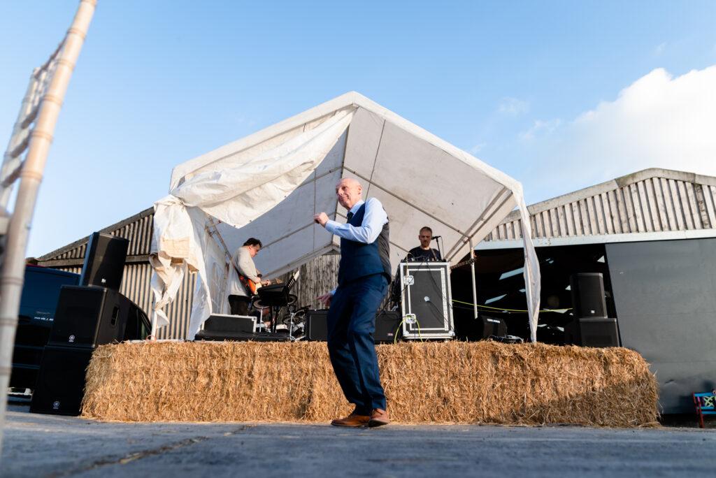 Wedding guest dancing outside Thornsett Fields Farm