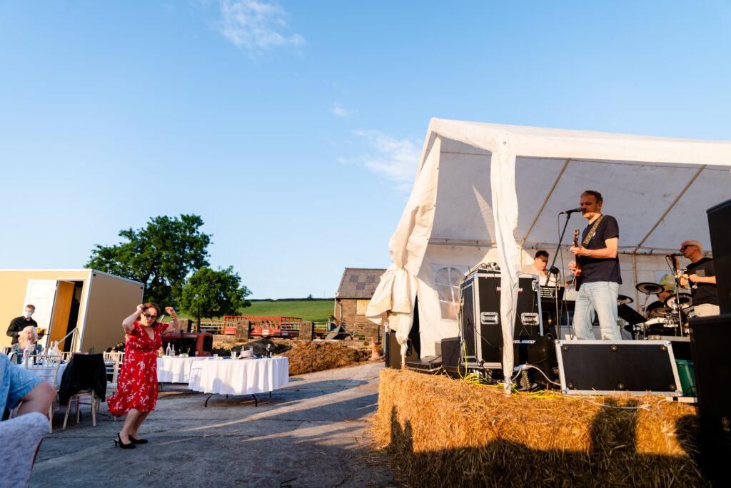 Wedding guest dancing alone outside Thornsett Fields Farm
