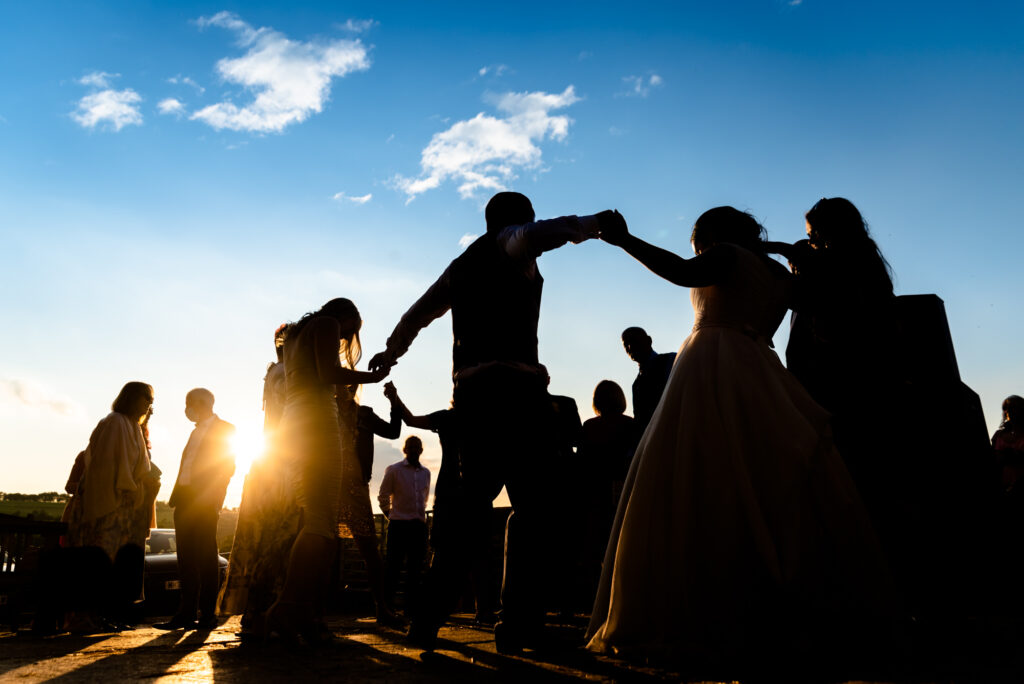 Wedding party in the sunset at Thornsett Fields Farm