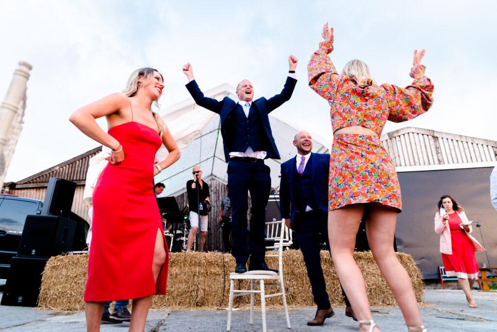 Guest dancing on a chair at Thornsett Fields Farm