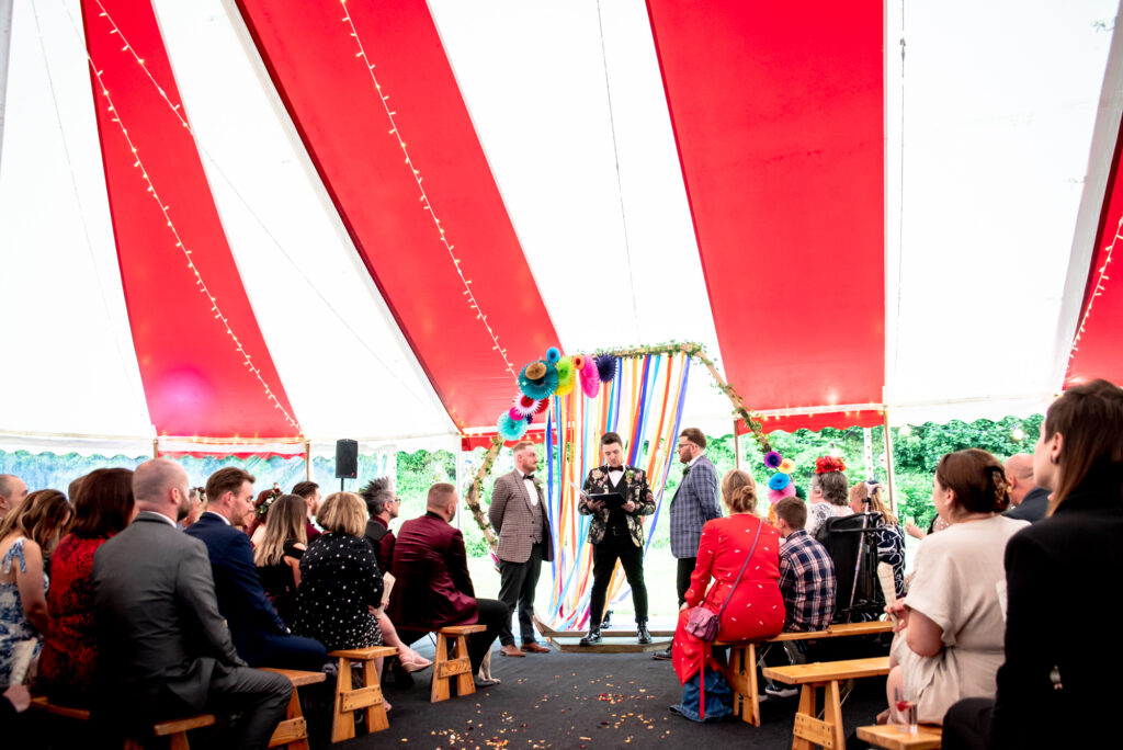 Ceremony under a circus tent at Gisburn Park Estate