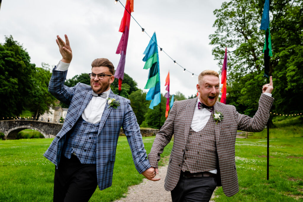 Grooms waving at their guests