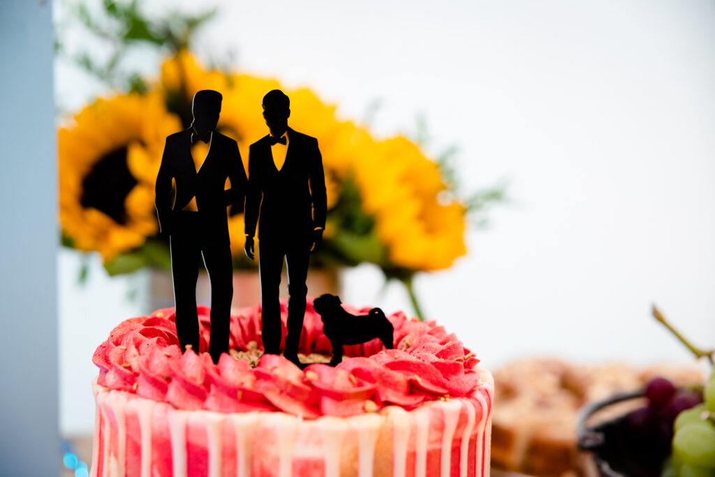 Two grooms and a dog cake topper