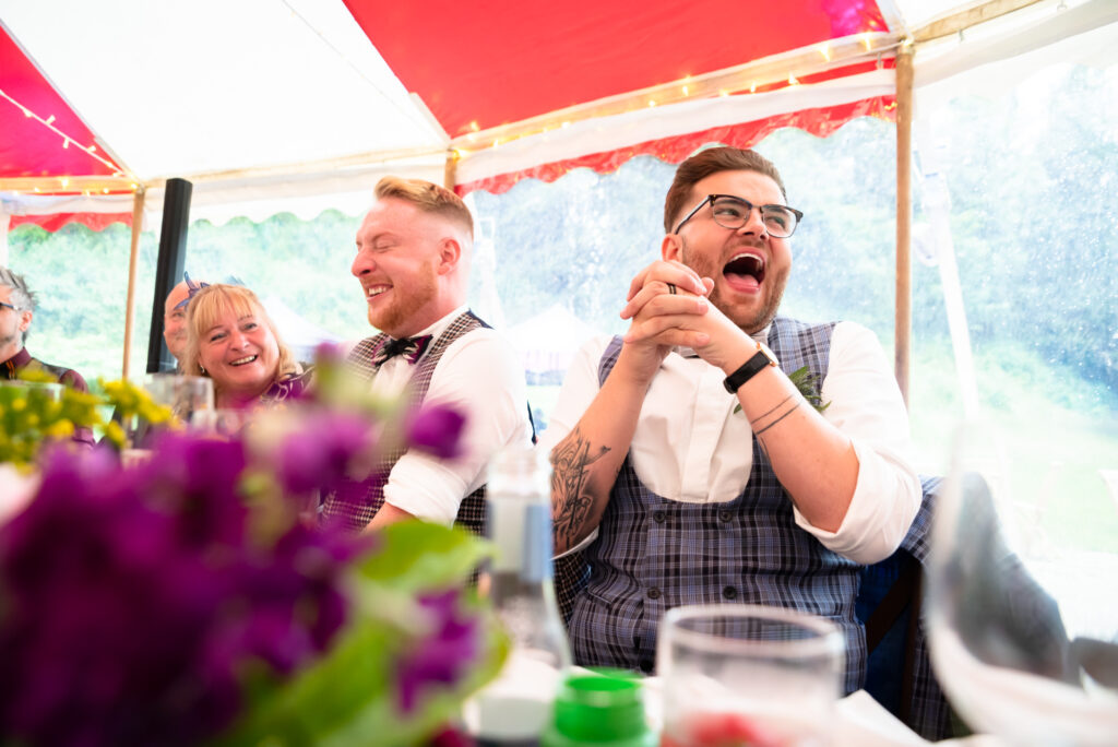 Couple laughing out loud during the speeches  at Gisburn Park Estate
