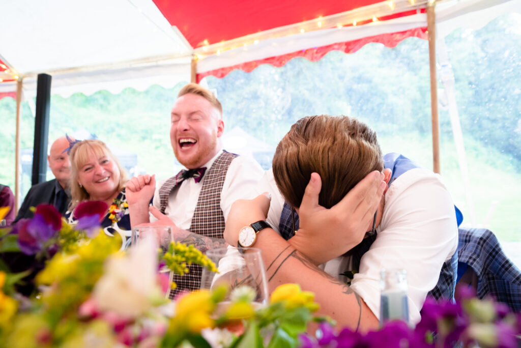 Groom hiding his face during the speeches