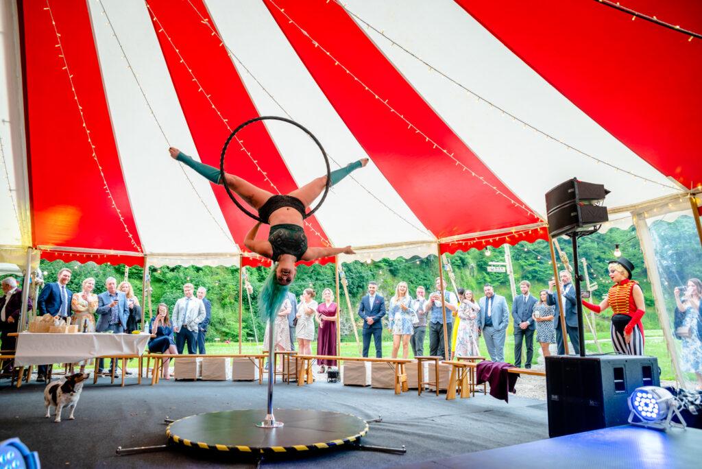 Bea Noir performing at a circus themed wedding at Gisburn Park Estate