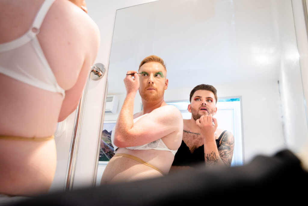 Grooms getting ready for their drag showThe First Dance at Gisburne Park Estate